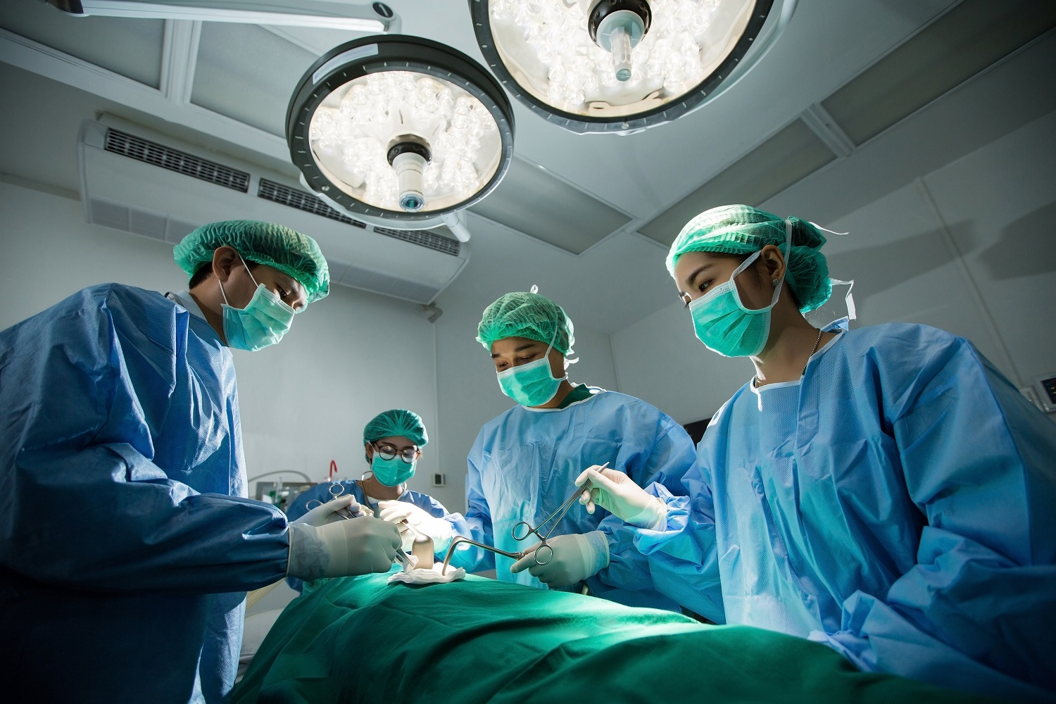 People wearing masks in operating room