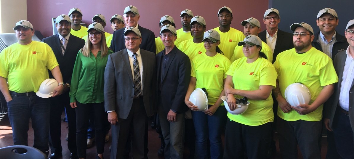 Construction graduates wearing Bucks hats